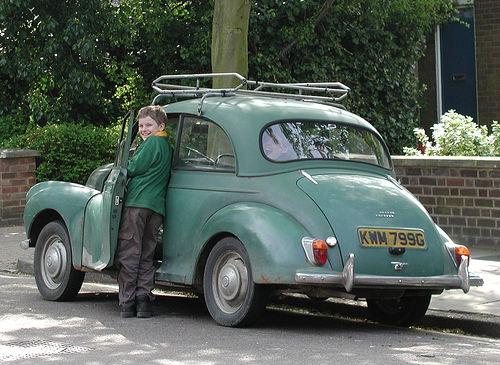 Boy entering car